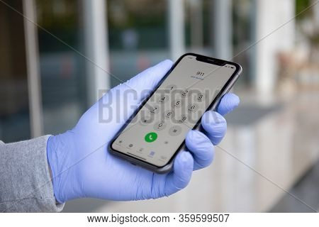 Alanya, Turkey - March 24, 2020: Man Hand In Disposable Protective Glove Holding Iphone 11 With Call