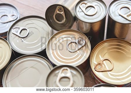 Various Canned Food In Metal Cans On Wooden Background , Top View - Canned Goods Non Perishable Food