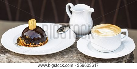 Cup Of Fresh Cappuccino. Chocolate Cake. Closeup. Cappuccino In A Cup, Hot Latte, Delicious Coffee.