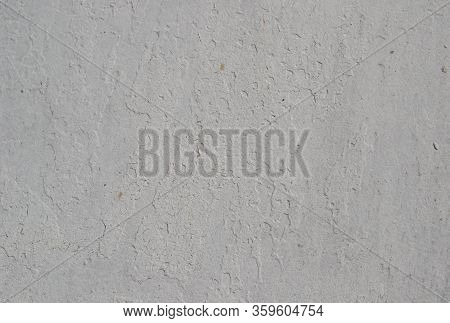 Textured Background In Gray With Small Cracks. Old, Dirty Paint Silver Color With A Heterogeneous Co