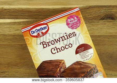Zaandam, The Netherlands - April 5, 2020: Package Of Dr. Oetker Brownies Choco Against A Wooden Bacl