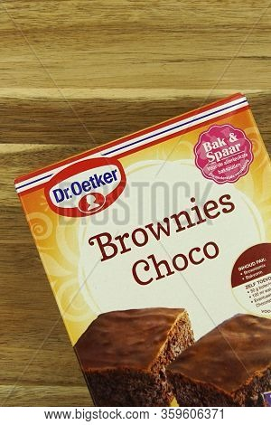 Zaandam, The Netherlands - April 4, 2020: Package Of Dr. Oetker Brownies Choco Against A Wooden Bacl