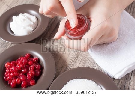 A Woman Puts Her Finger On A Natural Home Scrub. Skin Care. Natural Ingredients For Making A Scrub,