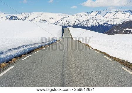 Bjorgavegen Mountain Road Between Aurland And Laerdal With Sides Still Covered With Snow In June In