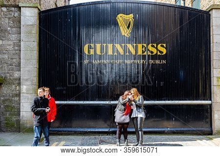 Dublin, Ireland - April 22, 2016: Street View Of People In Front Of The Historic Old Factory Buildin