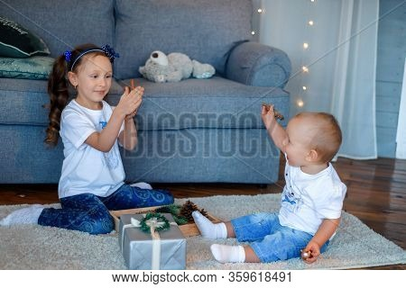 Cute Little Caucasian Kids Siblings Laughing And Playing At Home Show Love And Care, Small Girl Sist