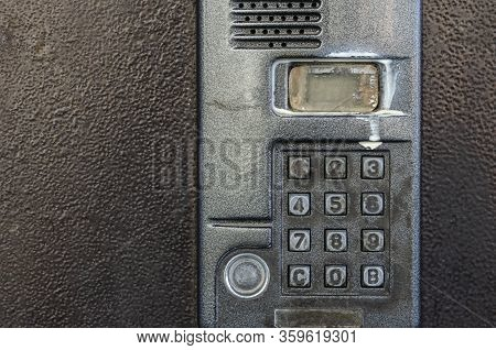 Dirty Intercom At The Door Of An Apartment Building. Unsanitary Condition Of The Intercom On The Fro