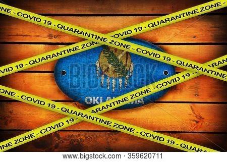 Covid-19 Warning Yellow Ribbon Written With: Quarantine Zone Cover 19 On Oklahoma Flag Illustration.