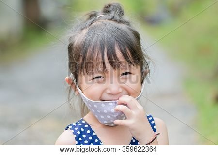 Little Girl Has Fabric Mask Protect Herself From Coronavirus Covid-19, Hand Stop Sign When Child Lea