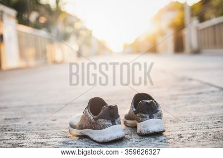Sports Shoes On Street Background.metaphor Fitness And Workout Concept Exercise Health Lifestyle Mus