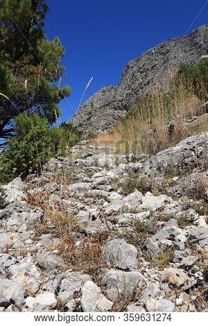 Forgotten Stone Road In A Secluded Part Of Gradac, Split-dalmatia County, Croatia. Dangerous Path Fo