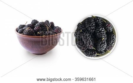 Mulberries In Bowl Isolated On White Background. Black Mulberry On White Background. Ripe And Tasty