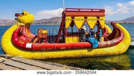 Titicaca Lake Peru, August 16. One Of The Typical Boats Made Of Totora Departing From A Floating Isl