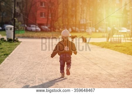 Child Girl Running To The Dogs In The Playground, Sunlight