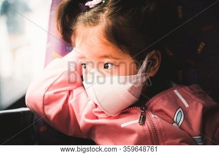 Child Wearing The Mask  To Reduce Spread Of The Coronavirus (covid-19) Outbreak From Human To Human