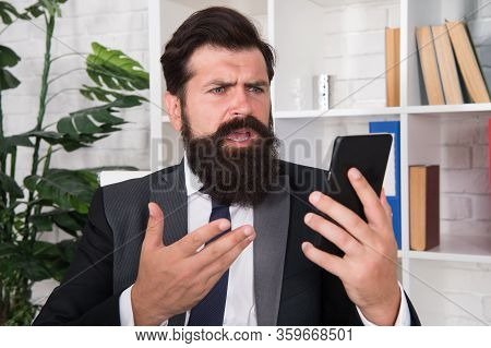 Stress From Work. Angry Manager Hold Smartphone In Office. Stress Management. Stressful Work. Busine