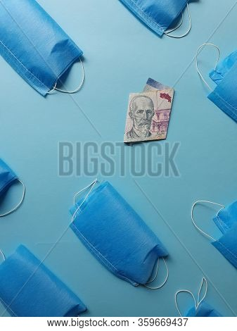 Costa Rican Banknote Of 2000 Colones And Masks On The Blue Background