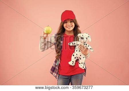 Apple Is Good Source Of Vitamin C. Happy Small Child Hold Vitamin Fruit On Pink Background. Little G
