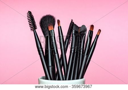 Set Of Professional Different Sizes Make Up Brushes On Pink Background
