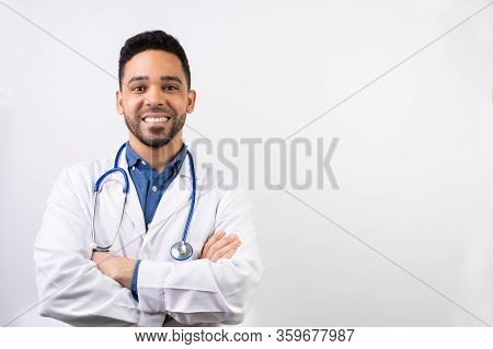 Latin American Young Doctor Over A White Background. Doctor Smiling To The Camera. Doctor Student Po