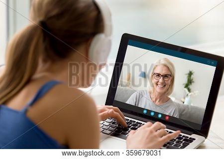 View Over Shoulder Adult Daughter Talks By Videocall With Mom