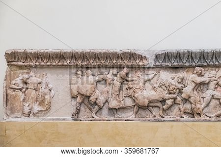 Delphi, Greece - September 21, 2017: Ancient Greek Parts Of Marble Plaque With Battle Scene In Museu