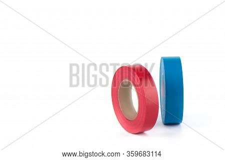 Red And Blue Insulating Tapes To Insulate Twisted Of Electrical Wires. Insulating Tapes Isolated On