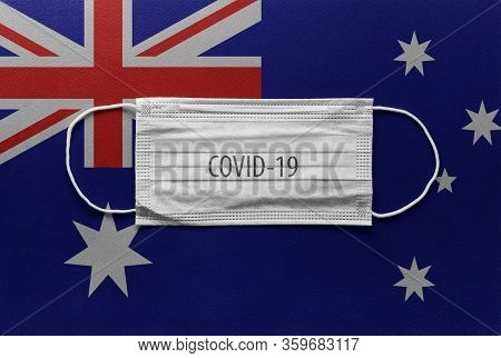 An Individual Face Medical Surgical Mask On Australia National Flag Background. Health Mask. Protect
