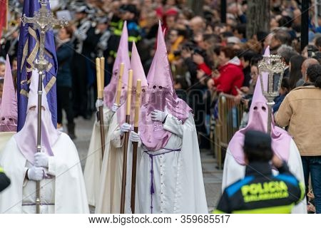 Salamanca, Spain - April 18, 2019: Typical Scene Of The Spanish Holy Week, With Religious Dressing T