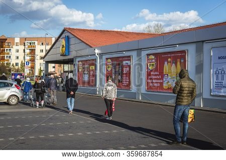 Warsaw, Poland - April 4, 2020: Waiting Line In Front Of Lidl Supermarket During Restriction Of Numb