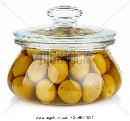 Whole Green Olives In Brine In A Closed Transparent Glass Oval Storage Jar With Glass Lid Isolated O
