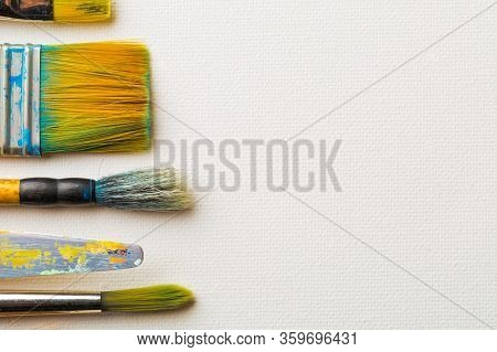 Artistic Art Supply Utensils With Paintbrushes On White Canvas Background With Copy Space Flat Lay T