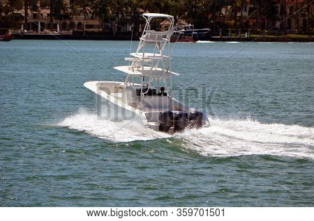 Sport Fishing Boat With Tuna Bridge Powered By Three Outboard Engines.