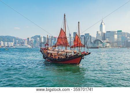 Retro Junk Departs To Hong Kong Island At Sunset Time.