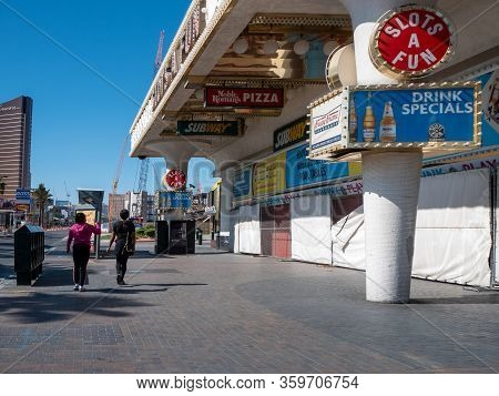4 April 2020, Las Vegas, Nevada, Usa, Two Women Walking On Deserted Las Vegas Boulevard In Front Of