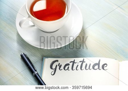 Gratitude Journal With A Pen And A Cup Of Tea