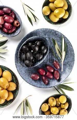 Olives, Green, Black And Red, Shot From Above On White