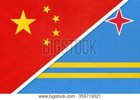China Or Prc Vs Aruba National Flag From Textile. Relationship Between Asian And American Countries.