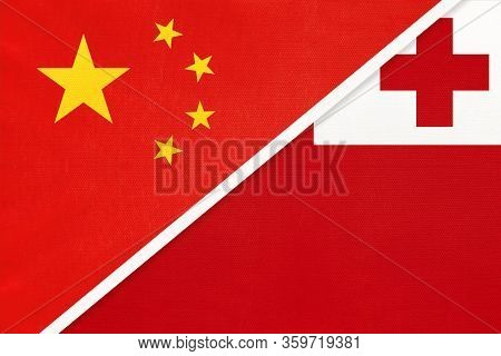 China Or Prc Vs Tonga National Flag From Textile. Relationship Between Asian And Oceania Countries.
