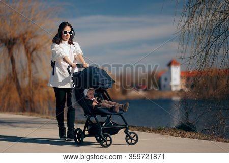 Upset Mom Walking Baby In Pushchair Stroller