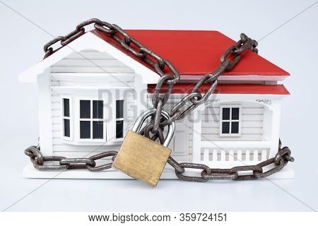 Lockdown: Timber Nz Villa Style House With Chain And Padlock - Home Security Concept