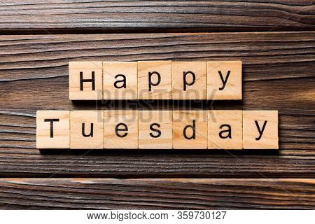 Happy Tuesday Word Written On Wood Block. Happy Tuesday Text On Wooden Table For Your Desing, Concep