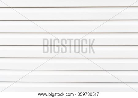 White Construction Vinyl Siding Panels. House Covered With Plastic Vinyl Siding. Vinyl Siding Wall S