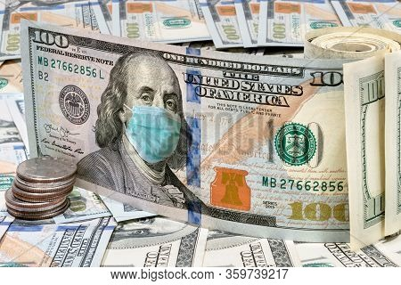 Coronavirus In Usa. 100 Dollar Money Bills With Medical Face Mask. Covid-19 Coronavirus Affects Glob
