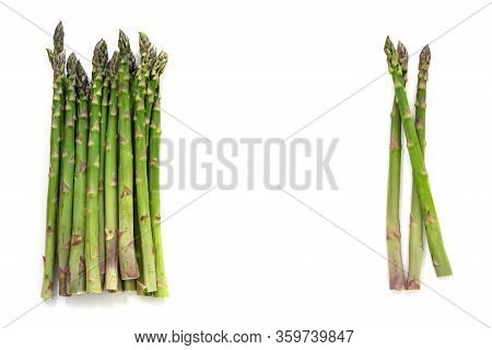 Two Bunches Of Organic Green Asparagus (asparagus Officinalis) And Copy Space In The Middle,  Isolat