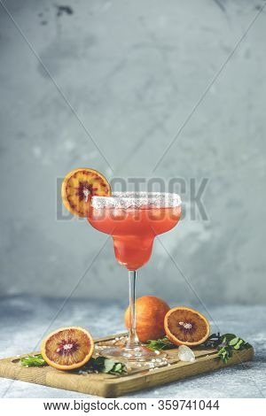 Red Orange Margarita Cocktail With Tequila, Triple Sec, Orange Juice, Crushed Ice And Some Salt On T