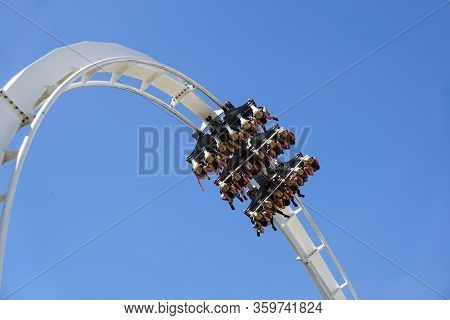 Roller Coaster Twisting Upside Down . Twist And Turns Of A Modern Steel Roller Coaster
