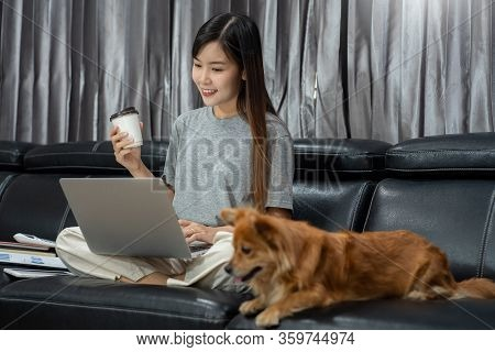 Beautiful Young Asian Woman Working Remotely From Home And Smiling While Lying, Has Good Relationshi