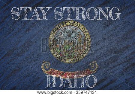 Covid-19 Warning. Quarantine Zone Covid 19 On Idaho ,flag Illustration. Coronavirus Danger Area, Qua