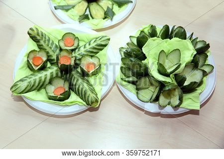 Vegetable Flowers . Cucumber Is Carved In Form Of Flowers Roses. Clipping Path Included . Cucumber F